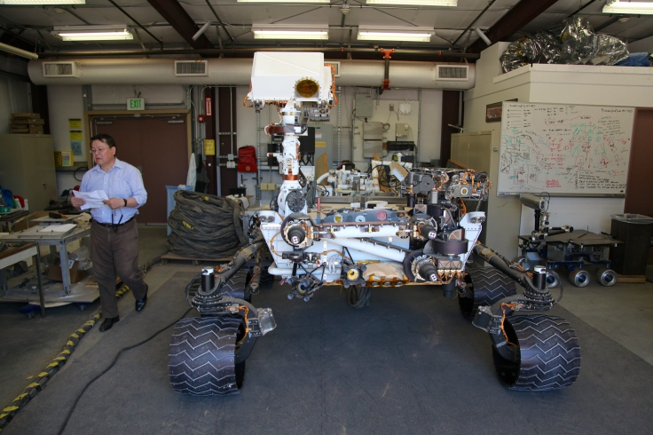 A nearly exact replica of the Curiosity rover lives in a garage at NASA Jet Propulsion Lab. It emerges about once a week to test new tasks and features. Photo by Signe Brewster.